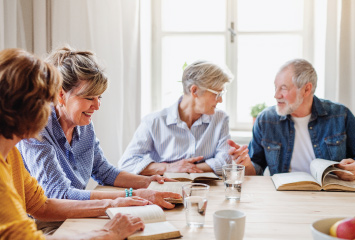 group of older adults having bible study