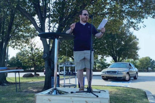 man delivering sermon outdoors